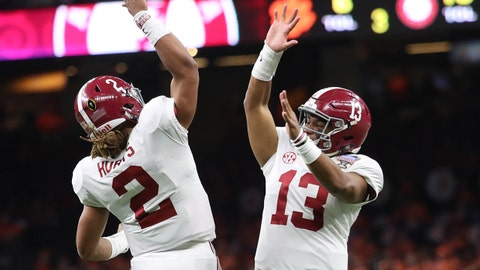 Jan 1, 2018; New Orleans, LA, USA; Alabama Crimson Tide quarterback Jalen Hurts (2) celebrates with quarterback Tua Tagovailoa (13) during the third quarter Clemson Tigers in the 2018 Sugar Bowl college football playoff semifinal game at Mercedes-Benz Superdome. Mandatory Credit: Kevin Jairaj-USA TODAY Sports