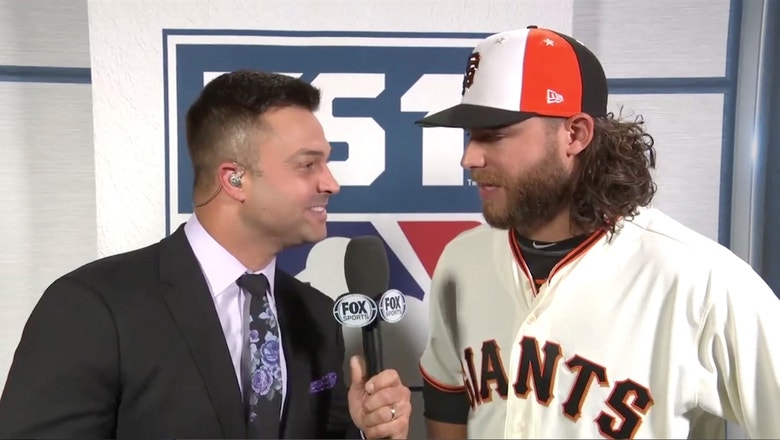 National League starting shortstop Brandon Crawford talks with Nick Swisher