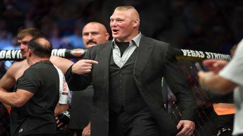 Jul 7, 2018; Las Vegas, NV, USA; Brock Lesnar enters the octagon after Daniel Cormier (blue gloves) beat Stipe Miocic (red gloves) during UFC 226 at T-Mobile Arena. Mandatory Credit: Stephen R. Sylvanie-USA TODAY Sports