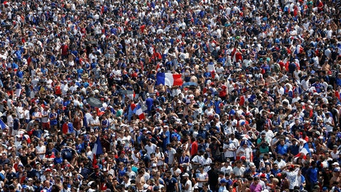 TOPSHOT - France supporters wave French flags as they gather on the fan zone to watch the Russia 2018 World Cup final football match between France and Croatia, on the Champ de Mars in Paris on July 15, 2018. (Photo by CHARLY TRIBALLEAU / AFP)        (Photo credit should read CHARLY TRIBALLEAU/AFP/Getty Images)