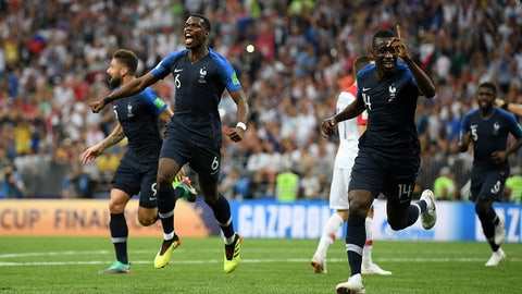 MOSCOW, RUSSIA - JULY 15:  Paul Pogba and Blaise Matuidi of France celebrates after Mario Mandzukic of Croatia scores an own goal for France's first goal during the 2018 FIFA World Cup Final between France and Croatia at Luzhniki Stadium on July 15, 2018 in Moscow, Russia.  (Photo by Matthias Hangst/Getty Images)