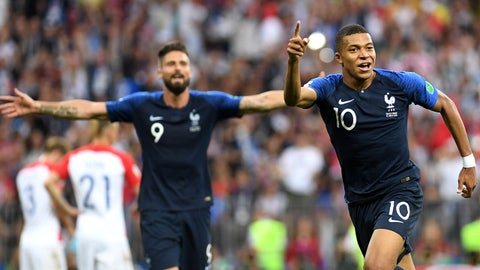 MOSCOW, RUSSIA - JULY 15:  Kylian Mbappe of France celebrates after scoring his team's fourth goal during the 2018 FIFA World Cup Final between France and Croatia at Luzhniki Stadium on July 15, 2018 in Moscow, Russia.  (Photo by Michael Regan - FIFA/FIFA via Getty Images)
