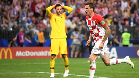 MOSCOW, RUSSIA - JULY 15:  Mario Mandzukic of Croatia celebrates after scoring his team's second goal past Hugo Lloris of France during the 2018 FIFA World Cup Final between France and Croatia at Luzhniki Stadium on July 15, 2018 in Moscow, Russia.  (Photo by Laurence Griffiths/Getty Images)