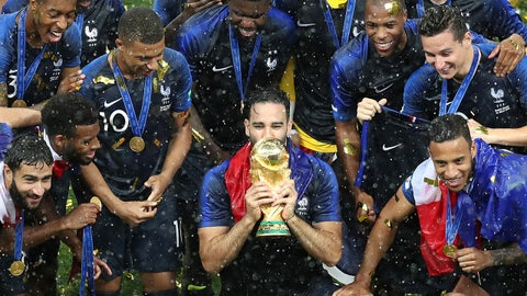 MOSCOW, RUSSIA - JULY 15:  Adil Rami of France and his teammates celebrate with the World Cup Trophy following their sides victory in the 2018 FIFA World Cup Final between France and Croatia at Luzhniki Stadium on July 15, 2018 in Moscow, Russia.  (Photo by Catherine Ivill/Getty Images)