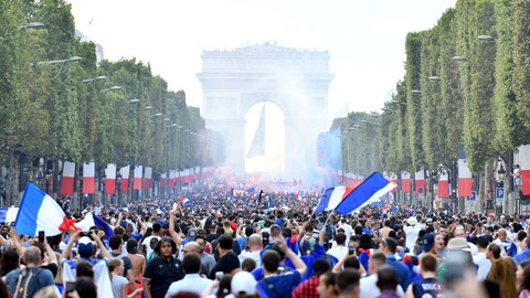 PARIS, FRANCE - JULY 15: French supporters celebrate France's World Cup victory after the FIFA World Cup 2018 final soccer match between France and Croatia, on the Champs-Elysees in Paris, France on July 15, 2018. (Photo by Mustafa Yalcin/Anadolu Agency/Getty Images)