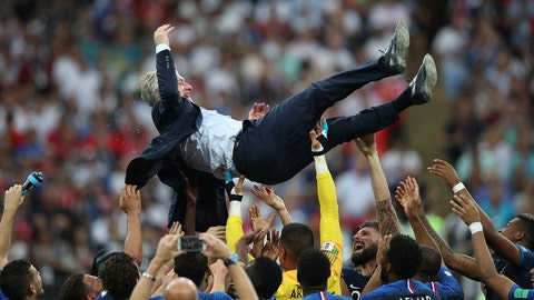 MOSCOW, RUSSIA - JULY 15: France coach Didier Deschamps is thrown in the air during the 2018 FIFA World Cup Russia Final between France and Croatia at Luzhniki Stadium on July 15, 2018 in Moscow, Russia. (Photo by Ian MacNicol/Getty Images)