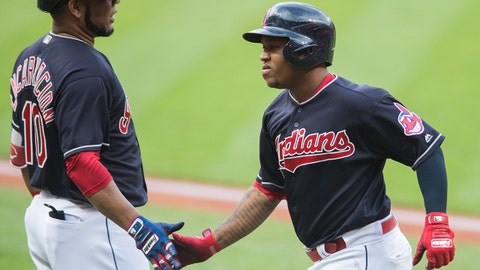 Jul 14, 2018; Cleveland, OH, USA; Cleveland Indians third baseman Jose Ramirez (11) celebrate with first baseman Edwin Encarnacion (10) after hitting a home run during the first inning against the New York Yankees at Progressive Field. Mandatory Credit: Ken Blaze-USA TODAY Sports