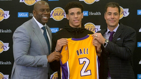 June 23, 2017; Los Angeles, CA, USA;  Newly drafted Los Angeles Lakers player Lonzo Ball (center) poses with basketball operations president Magic Johnson and general manager Rob Pelinka during his introductory press conference at Toyota Sports Center. Mandatory Credit: Gary A. Vasquez-USA TODAY Sports
