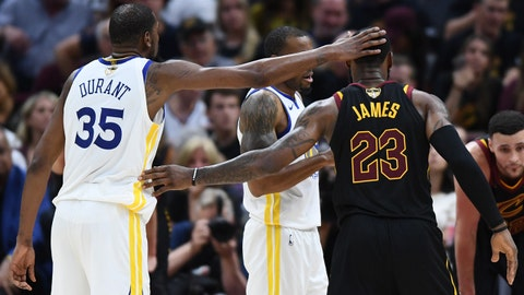 Jun 8, 2018; Cleveland, OH, USA; Golden State Warriors forward Kevin Durant (35) and Cleveland Cavaliers forward LeBron James (23) react in game four of the 2018 NBA Finals at Quicken Loans Arena. Mandatory Credit: Ken Blaze-USA TODAY Sports