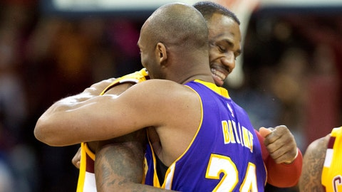 Feb 10, 2016; Cleveland, OH, USA; Cleveland Cavaliers forward LeBron James (23) hugs Los Angeles Lakers forward Kobe Bryant (24) prior to their game at Quicken Loans Arena. Mandatory Credit: David Richard-USA TODAY Sports