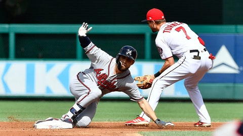 Jul 22, 2018; Washington, DC, USA; Atlanta Braves center fielder Ender Inciarte (11) slides safely into second base for a double beating the tag attempt of Washington Nationals shortstop Trea Turner (7) during the second inning at Nationals Park. Mandatory Credit: Brad Mills-USA TODAY Sports