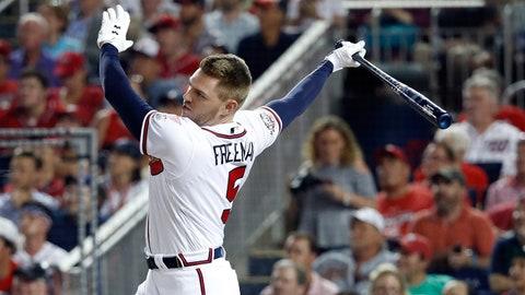 Jul 16, 2018; Washington, DC, USA; Atlanta Braves first baseman Freddie Freeman (5) bats in the first round during the 2018 MLB home run derby at Nationals Ballpark. Mandatory Credit: Geoff Burke-USA TODAY Sports