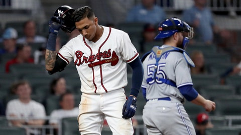 Jul 10, 2018; Atlanta, GA, USA; Atlanta Braves third baseman Johan Camargo (17) reacts after striking out in the eight inning against the Toronto Blue Jays at SunTrust Park. Mandatory Credit: Jason Getz-USA TODAY Sports