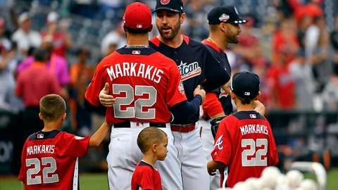 Jul 16, 2018; Washington, DC, USA; American League pitcher Gerrit Cole of the Houston Astros (45) greets National League outfielder Nick Markakis of the Atlanta Braves (22) during workouts in preparation for the 2018 MLB All Star Game at Nationals Ballpark. Mandatory Credit: Brad Mills-USA TODAY Sports