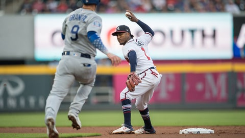Jul 26, 2018; Atlanta, GA, USA; Atlanta Braves second baseman Ozzie Albies (1) turns a double play past Los Angeles Dodgers catcher Yasmani Grandal (9) during the second inning at SunTrust Park. Mandatory Credit: Dale Zanine-USA TODAY Sports