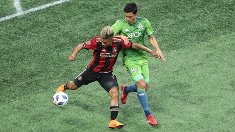 Jul 15, 2018; Atlanta, GA, USA; Atlanta United forward Josef Martinez (7) controls the ball against Seattle Sounders midfielder Kim Kee-Hee (20) in the first half at Mercedes-Benz Stadium. Mandatory Credit: Jason Getz-USA TODAY Sports