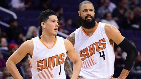 Jan 3, 2017; Phoenix, AZ, USA;  Phoenix Suns guard Devin Booker (1) and center Tyson Chandler (4) talk on the court in the first half of the NBA game against the Miami Heat at Talking Stick Resort Arena. Mandatory Credit: Jennifer Stewart-USA TODAY Sports