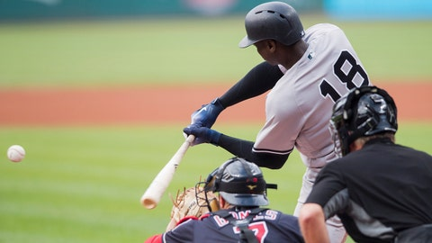 Jul 14, 2018; Cleveland, OH, USA; New York Yankees shortstop Didi Gregorius (18) hits a home run during the first inning against the Cleveland Indians at Progressive Field. Mandatory Credit: Ken Blaze-USA TODAY Sports