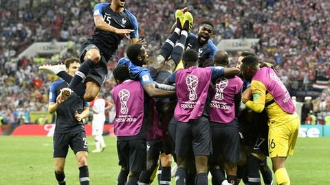 France subs swarm the pitch to celebrate