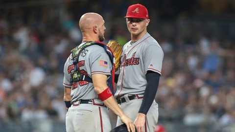 Jul 3, 2018; Bronx, NY, USA; Atlanta Braves catcher Tyler Flowers (25) has a meeting with pitcher Sean Newcomb (15) in the third inning against the New York Yankees at Yankee Stadium. Mandatory Credit: Wendell Cruz-USA TODAY Sports