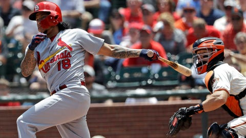St. Louis Cardinals' Carlos Martinez, left, drives in a run with a double against the San Francisco Giants during the third inning of a baseball game Saturday, July 7, 2018, in San Francisco. (AP Photo/Marcio Jose Sanchez)