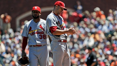 St. Louis Cardinals starting pitcher Jack Flaherty, right, waits to be pulled from a baseball game against San Francisco Giants during the third inning Sunday, July 8, 2018, in San Francisco. (AP Photo/Marcio Jose Sanchez)