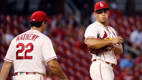 St. Louis Cardinals relief pitcher Jordan Hicks, right, waits on the mound to be removed by manager Mike Matheny during the seventh inning of the team's baseball game against the Cincinnati Reds Saturday, July 14, 2018, in St. Louis. (AP Photo/Jeff Roberson)