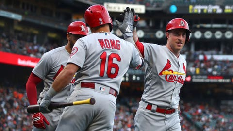St. Louis Cardinals' Jedd Gyorko, right, is congratulated by Kolten Wong (16) after hitting a three-run home run off San Francisco Giants' Johnny Cueto during the first inning of a baseball game Thursday, July 5, 2018, in San Francisco. (AP Photo/Ben Margot)