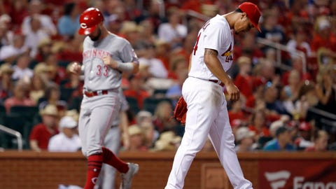 St. Louis Cardinals relief pitcher Sam Tuivailala, right, walks back to the mound as Cincinnati Reds' Jesse Winker scores during the seventh inning of a baseball game Friday, July 13, 2018, in St. Louis. (AP Photo/Jeff Roberson)