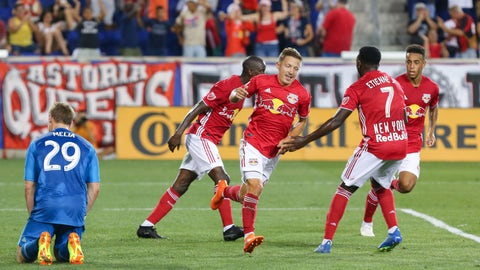 Jul 14, 2018; Harrison, NJ, USA; New York Red Bulls midfielder Marc Rzatkowski (90) celebrates his goal past Sporting Kansas City goalkeeper Tim Melia (29) with midfielder Derrick Etienne (7) and forward Bradley Wright-Phillips (99) and midfielder Tyler Adams (4) during the second half at Red Bull Arena. Mandatory Credit: Vincent Carchietta-USA TODAY Sports
