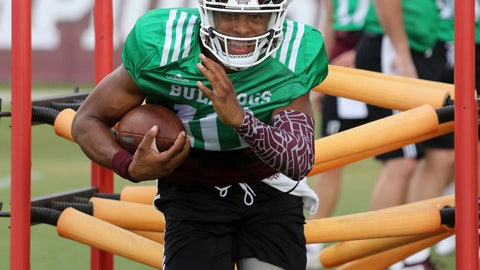 """<p>               FILE - In this Aug. 10, 2018, file photo, Mississippi State quarterback Keytaon Thompson protects the ball during NCAA college football practice in Starkville, Miss. No. 18 Mississippi State will play their opener Saturday, Aug. Sept. 1, against Stephen F. Austin without senior starting quarterback Nick Fitzgerald, who was suspended for the first game because of a """"violation of team policy"""" that happened in March. Thompson will start instead and head coach Joe Moorhead doesn't expect any dropoff in performance. (AP Photo/Jim Lytle, File)             </p>"""