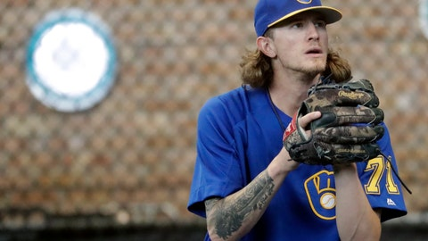 <p>               FILE - In this July 20, 2018, file photo, Milwaukee Brewers relief pitcher Josh Hader warms up before a baseball game against the Los Angeles Dodgers in Milwaukee. Whatever progress baseball has made promoting inclusion, it took a backseat recently. Years-old racist, misogynist and homophobic tweets from Milwaukee reliever Josh Hader were found during the All-Star Game.  (AP Photo/Morry Gash, File)             </p>