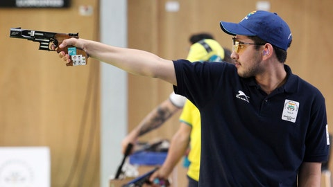 <p>               In this April 13, 2018, file photo, Anish Bhanwala of India shoots during the men's 25m Rapid Fire Pistol final at the Belmont Shooting Centre during the 2018 Commonwealth Games in Brisbane, Australia. At 15 and still at high school, Anish was India's youngest gold medalist at the Commonwealth Games on Australia's Gold Coast in April when he won the 25-meter rapid fire pistol shooting event in a meet record. (AP Photo/Tertius Pickard, File)             </p>