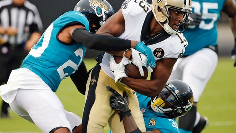<p>               New Orleans Saints wide receiver Michael Thomas (13) is stopped after a reception by Jacksonville Jaguars cornerback Jalen Ramsey, left, and defensive back Tashaun Gipson during the first half of an NFL preseason football game Thursday, Aug. 9, 2018, in Jacksonville, Fla. (AP Photo/Stephen B. Morton)             </p>