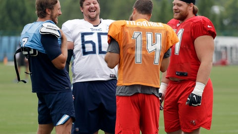 <p>               Tennessee Titans quarterback Blaine Gabbert (7), left, and center Ben Jones (60) talk with Tampa Bay Buccaneers quarterback Ryan Fitzpatrick (14) and defensive tackle Beau Allen (91) during a combined NFL football training camp Thursday, Aug. 16, 2018, in Nashville, Tenn. (AP Photo/Mark Humphrey)             </p>