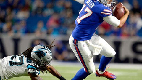 <p>               FILE - In this Aug. 9, 2018, file photo, Buffalo Bills quarterback Josh Allen, right, avoids a tackle by Carolina Panthers defensive back Dezmen Southward during the second half of an NFL football game, in Orchard Park, N.Y. The decision to name Allen the starter provides the first-round draft pick out of Wyoming an opportunity to secure the No. 1 job following an offseason-long three-way competition.(AP Photo/Adrian Kraus, File)             </p>