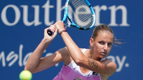 <p>               Karolina Pliskova, of the Czech Republic, returns to Agnieszka Radwańska, of Poland, at the Western & Southern Open, Tuesday, Aug. 14, 2018, in Mason, Ohio. (AP Photo/John Minchillo)             </p>