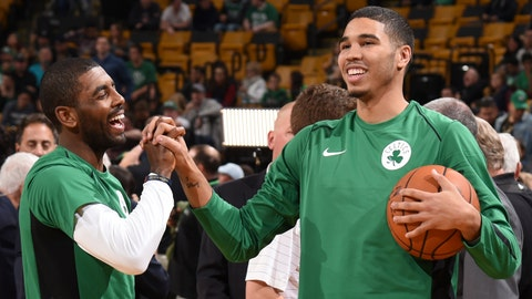 BOSTON, MA - OCTOBER 2: Jayson Tatum #0 and Kyrie Irving #11 of the Boston Celtics talk before the game against the Charlotte Hornets during a preseason game on October 2, 2017 at the TD Garden in Boston, Massachusetts.  NOTE TO USER: User expressly acknowledges and agrees that, by downloading and or using this photograph, User is consenting to the terms and conditions of the Getty Images License Agreement. Mandatory Copyright Notice: Copyright 2017 NBAE  (Photo by Brian Babineau/NBAE via Getty Images)