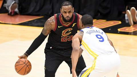 CLEVELAND, OH - JUNE 08:  LeBron James #23 of the Cleveland Cavaliers defended by Andre Iguodala #9 of the Golden State Warriors in the first half during Game Four of the 2018 NBA Finals at Quicken Loans Arena on June 8, 2018 in Cleveland, Ohio. NOTE TO USER: User expressly acknowledges and agrees that, by downloading and or using this photograph, User is consenting to the terms and conditions of the Getty Images License Agreement.  (Photo by Jason Miller/Getty Images)