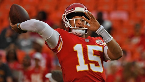 KANSAS CITY, MO - AUGUST 09:  Quarterback Patrick Mahomes #15 of the Kansas City Chiefs throws a a pass during pre-game warmups, prior to a pre-season game against the Houston Texans on August 9, 2018 at Arrowhead Stadium in Kansas City, Missouri.  (Photo by Peter Aiken/Getty Images)