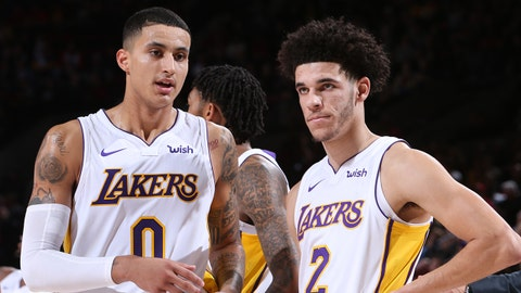 PORTLAND, OR - NOVEMBER 2:   Kyle Kuzma #0 of the Los Angeles Lakers and Lonzo Ball #2 of the Los Angeles Lakers are seen on the court during the game against the Portland Trail Blazers on November 2, 2017 at the Moda Center in Portland, Oregon. NOTE TO USER: User expressly acknowledges and agrees that, by downloading and or using this Photograph, user is consenting to the terms and conditions of the Getty Images License Agreement. Mandatory Copyright Notice: Copyright 2017 NBAE (Photo by Sam Forencich/NBAE via Getty Images)