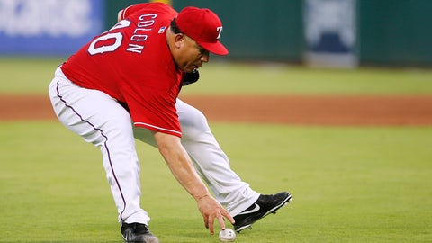 <p>               Texas Rangers starting pitcher Bartolo Colon fields a soft infield hit by Seattle Mariners' Cameron Maybin during the fourth inning of a baseball game, Tuesday, Aug. 7, 2018, in Arlington, Texas. Colon threw to first for the out. The Rangers won 11-4. (AP Photo/Brandon Wade)             </p>