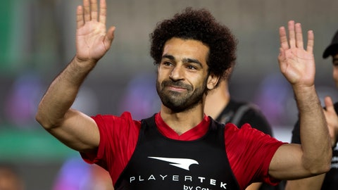 <p>               FILE - In this June 9, 2018, file photo, Egyptian national team soccer player and Liverpool's star striker Mohamed Salah smiles as he greets fans during the final training of the national team at Cairo Stadium in Cairo, Egypt. Salah has revived a months-long dispute with soccer authorities in his native Egypt, accusing them of ignoring his complaints about their unauthorized use of his image. (AP Photo/Amr Nabil, File)             </p>