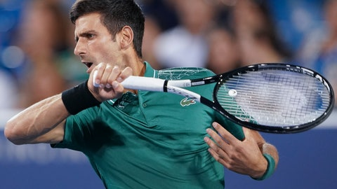 <p>               Novak Djokovic, of Serbia, returns to Steve Johnson in the first round at the Western & Southern Open, Monday, Aug. 13, 2018, in Mason, Ohio. (AP Photo/John Minchillo)             </p>