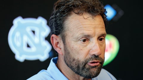 <p>               North Carolina coach Larry Fedora makes comments during the NCAA college football team's media day in Chapel Hill, N.C., Monday, Aug. 6, 2018. Following an NCAA violation involving the sale of team-issued shoes, the university announced today that 13 football players will miss games during the 2018 season. (AP Photo/Gerry Broome)             </p>