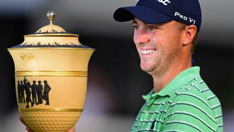 <p>               Justin Thomas holds the Gary Player Cup trophy after winning the final round of the Bridgestone Invitational golf tournament at Firestone Country Club, Sunday, Aug. 5, 2018, in Akron, Ohio. (AP Photo/David Dermer)             </p>