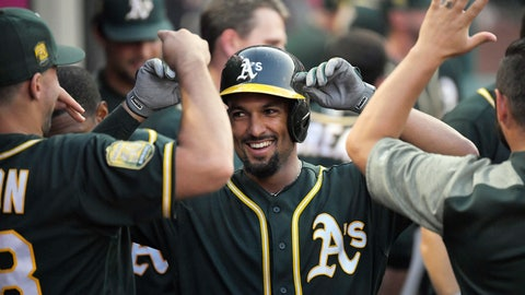 <p>               Oakland Athletics' Marcus Semien, center, is congratulated by teammates after hitting a solo home run during the fourth inning of a baseball game against the Los Angeles Angels on Saturday, Aug. 11, 2018, in Anaheim, Calif. (AP Photo/Mark J. Terrill)             </p>