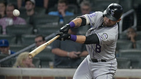 <p>               Colorado Rockies' Gerardo Parra hits a line drive single to left field for an RBI against the Atlanta Braves during the ninth inning of a baseball game Saturday, Aug. 18, 2018, in Atlanta. (AP Photo/John Amis)             </p>