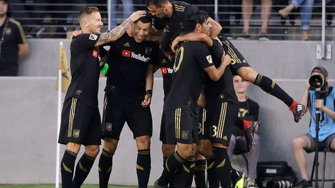 <p>               Los Angeles FC's Christian Ramirez, second from left, is mobbed by teammates after scoring against Real Salt Lake during the first half of an MLS soccer match Wednesday, Aug. 15, 2018, in Los Angeles. (AP Photo/Marcio Jose Sanchez)             </p>