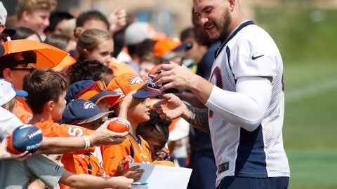 <p>               Denver Broncos defensive end Adam Gotsis signs autographs for fans after drills at an NFL football training camp at the team's headquarters Tuesday, Aug. 14, 2018, in Englewood, Colo. (AP Photo/David Zalubowski)             </p>
